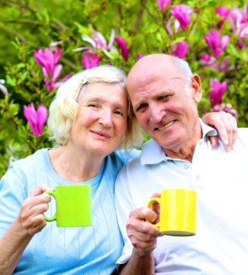 older couple with cups